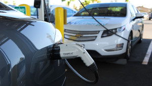 ChargePoint SAE J1772 AC Level 2 plugged into Tesla Motors Model S through adapter plug.  Chevrolet Volt plugged in behind it.