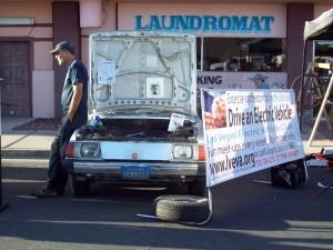 Jon Hallquist, Vice President of the Las Vegas Electric Vehicle Association exhibits a Subaru Brat EV conversion.