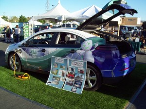 NV Energy Chevrolet Volt fleet vehicle with SAE J1772 AC Level 1 EVSE and NEVA poster board display.