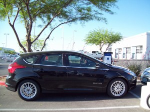 Ford Focus Electric parked near Leviton SAE J1772 AC Level 2 EVSE at Gaudin Ford