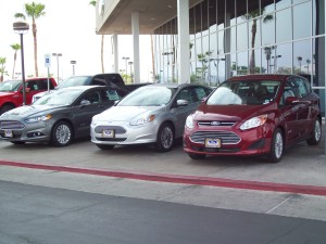 Latest Ford electrified models from left to right - Fusion Energi plug-in hybrid, Focus Electric, and C-Max hybrid at Ford Country in Henderson.