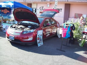 Findlay Chevrolet in Las Vegas loaned NEVA a Chevrolet Volt wrapped with UNLV logo and Rebel mascot for Green Street display.