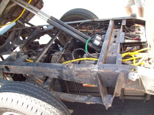 An electro-hydraulic lift raises the bed of the Ford F-150 electric truck so that the traction battery pack can be serviced.