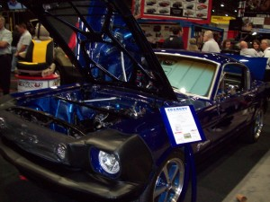 Sparkey, an electric 1965 Mustang Fastback at SEMA car show, has been converted to run on batteries and an electric motor.