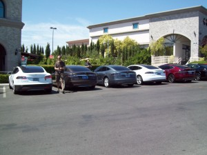 Don Carrier and Matt Watson, co-founders of the Tesla Motors Owners Group of Las Vegas line up the members' Model S vehicles during a monthly meeting at Dom DeMarco's Pizzeria in Summerlin.