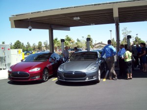 Don Carrier and Matt Watson, co-founders of the Tesla Motors Owners Group of Las Vegas, showcase their Model S electric cars at a NEVA electric vehicle infrastructure training workshop under a solar-powered recharging station at NV Energy Pearson campus.