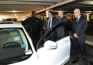 Rod Collins from Gaudin Ford demonstrates a Fusion Energi plug-in hybrid to NV Energy executives.