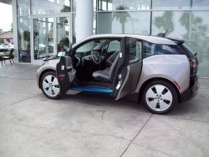 BMW i3 can be configured as electric-only for a range of 80 to 100 miles or as a range-extended vehicle with a gasoline generator that can provide 220 miles total.