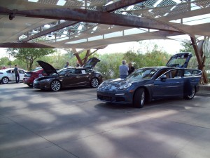 From right to left - Porsche Panamera S E-Hybrid, Tesla Motors Model S, Chevrolet Volt, and Ford Focus Electric
