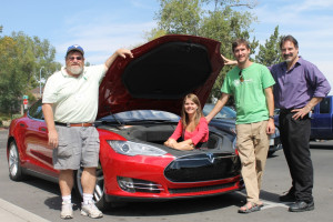 "Tesla owner Guy Hall (l) showed the additional cargo space available in his Model S Sedan to Willow Ronska, David Gibson of the Nevada Governor's Office of Energy, and Tom Polikalas of the Southwest Energy Efficiency Project (SWEEP) at the ""Drive Electric"" event held at Virginia Lake in Reno on Sat., Sept. 20, 2014."