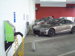 A Tesla Model S and Chevy Volts recharge at the Las Vegas City Hall Parking Garage.