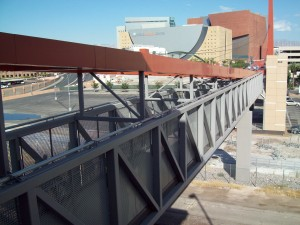A walking bridge on the third floor of the Las Vegas City Hall parking garage crosses over railroad tracks to the World Market Center and Smith Center