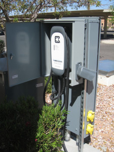 A Clipper Creek SAE J1772 AC Level 2 charging station sits near to four Tesla High-Power charging stations at Eureka Casino Resort in Mesquite.