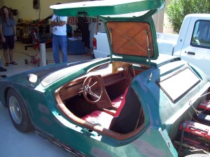 Cockpit view of Aztec kit car that employs Volkswagen Beetle chassis and fiberglass Lamborghini-style body with gull wing doors.