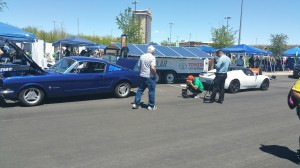 Larry Gareffa (in white hat) recharges Sparkey, the 1965 Mustang Fastback EV Conversion from solar-powered ChargePoint station provided by DC Solar and Las Vegas Motor Speedway during GreenFest 2016.