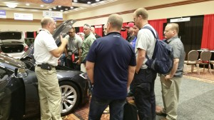 Jason Emery, NFPA instructor and firefighter, shows battery disconnection points on a Tesla Motors Model S P90D
