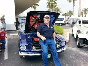 Larry Gareffa with his custom EV conversion of a 1965 Mustang Fastback.
