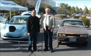 Lectra Motors co-founder and CEO Al Sawyer (right) with a 2012 Nissan LEAF and 1981 Lectra Motors Centauri.