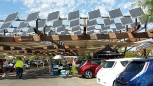 Four Nissan LEAFs charge up from SAE J1772 plugs at two ChargePoint stations powered by sunlight from photovoltaic solar panels that track the sun during the day.