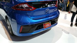 "The red Nevada plate with sideways ""infinity"" symbol denotes the car as having self-driving, autonomous capabilities."