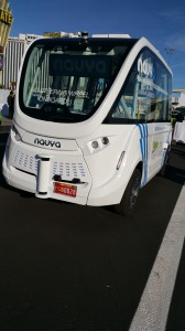 Frontal view of NAVYA ARMA bus showing lidar sensors and red Nevada autonomous vehicle license plate