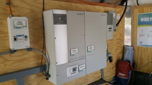 AC Inverter system provides 110 VAC from solar panels and wind generator.