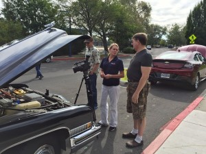 (Photo courtesy of Cynthia Ryan) KOLO-TV, Reno, NV learns about electric CARS from William Brinsmead of Reno, NV. He was at the NDEW with his 1972 Cadillac Hearse conversion - a familiar sight around the area.