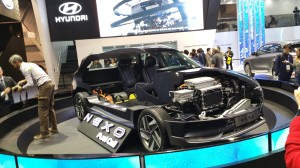 Hyundai displayed a cutaway version of its Nexo fuel-cell electric car, including the hydrogen fuel tank and electric-motor drive train.